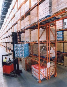 stacking shelves in warehouse