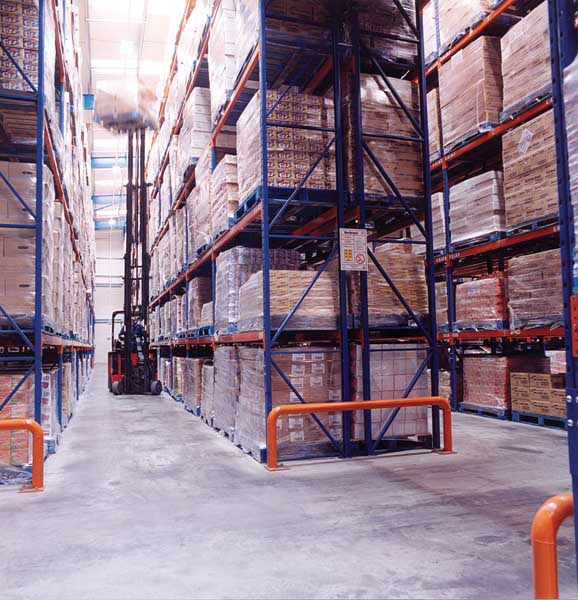 Specialist reach trucks operating in a Redirack Narrow Aisle system