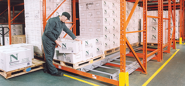 man loading racking with pallets